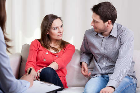 Photo for Happy young marriage starting new life after therapy session - Royalty Free Image