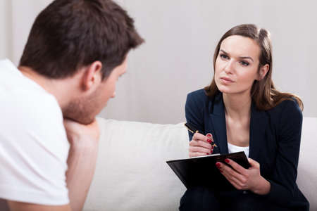 Photo for Professional experienced therapist conducting interview with patient - Royalty Free Image