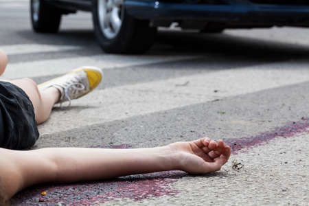 Photo for Close-up of unconscious woman at accident scene - Royalty Free Image
