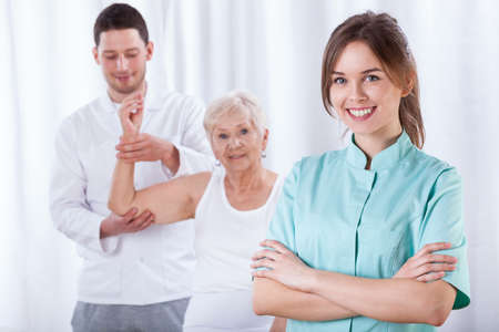 Photo for Elder woman exercising with her physical therapist - Royalty Free Image