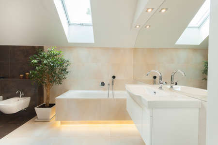 Photo pour Beautiful modern bathroom with big illuminated bathtube - image libre de droit