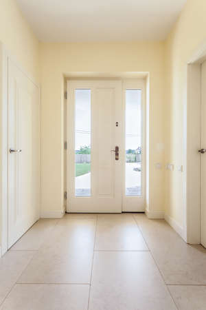 Foto de Bright clean corridor with window door in modern house - Imagen libre de derechos