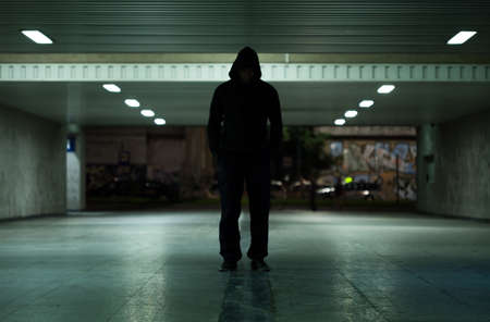 Foto de View of dangerous man walking at night - Imagen libre de derechos