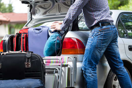 Foto de Too little car trunk for family luggage - Imagen libre de derechos