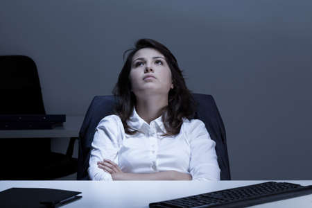 Photo pour View of thoughtful businesswoman in the office - image libre de droit