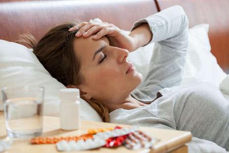 Foto de Horizontal view of woman suffering from flu - Imagen libre de derechos