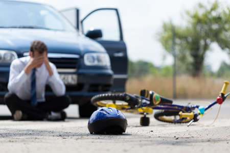Photo for Driver sitting on the street  after car accident - Royalty Free Image