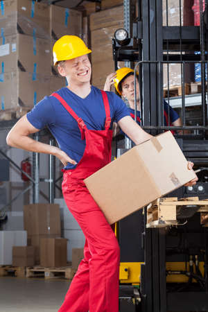 Photo for Man with a backache in a factory - Royalty Free Image