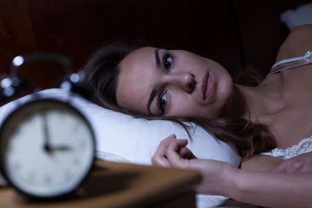 Photo pour Woman lying in bed suffering from insomnia - image libre de droit