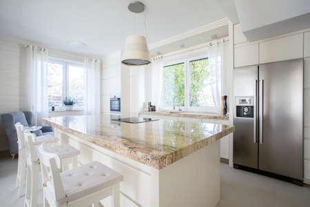 Foto de View of kitchen island in bright house - Imagen libre de derechos