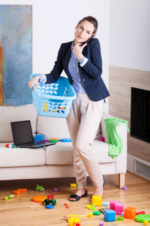 Photo pour Being a businesswoman and young housekeeper, vertical - image libre de droit