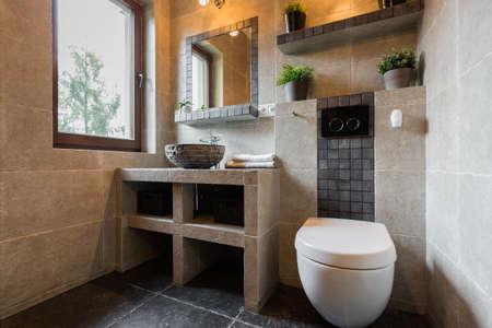 Foto de Modern beauty toilet interior with marble tiles - Imagen libre de derechos