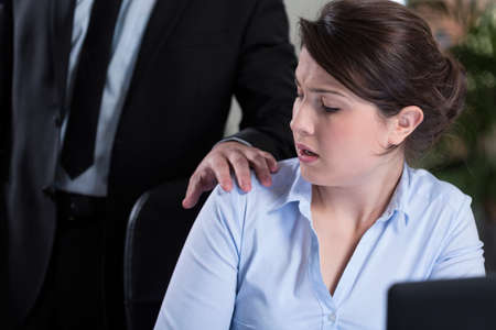 Photo pour Young attractive woman and workplace harassment - image libre de droit