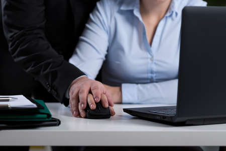 Photo for Close-up of boss mobbing his employee at work - Royalty Free Image