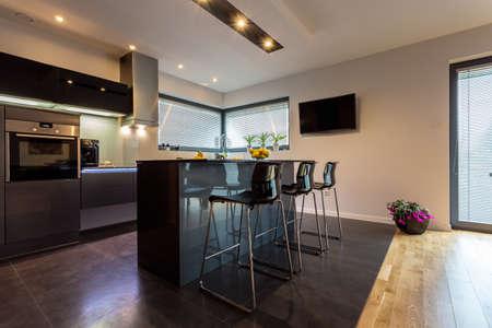 Photo pour Modern luxury kitchen interior with steel elements - image libre de droit