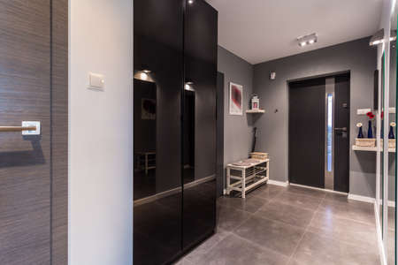 Photo for Anteroom with gray painted wall in contemporary residence - Royalty Free Image