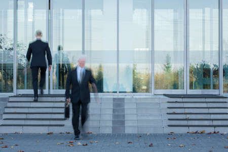 Photo for Two employees passing through the office's door - Royalty Free Image