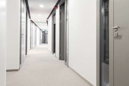 Photo for Long corridor with a lot of doors - Royalty Free Image