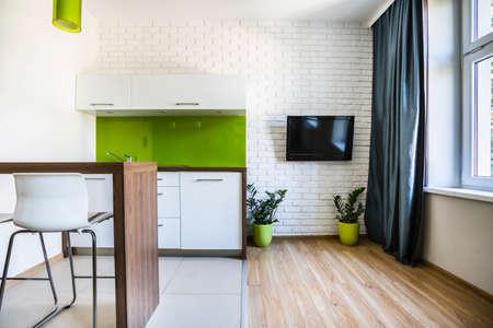 Photo pour Modern studio flat interior with white bricks - image libre de droit