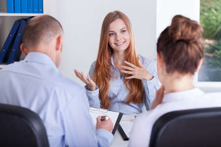 Photo for Girl talks about her experience for an job interview - Royalty Free Image