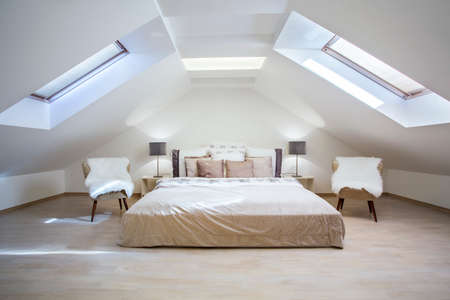 Foto de Bright attic bedroom in the fashionable apartment - Imagen libre de derechos