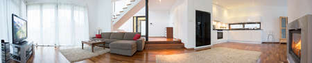 Photo pour Panoramic view of modern interior with living room and kitchen - image libre de droit