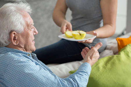 Foto per Elderly man eating fruit for dessert - Immagine Royalty Free
