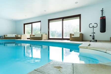Foto de View of swimming pool inside expensive house - Imagen libre de derechos