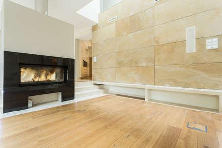 Photo pour Burning fireplace in beige stylish house - image libre de droit