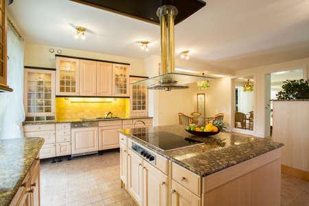 Photo pour Horizontal view of kitchen with marble worktop - image libre de droit