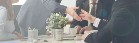 Photo pour Panorama of handshake on a business meeting - image libre de droit