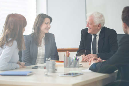 Photo pour Four elegant businesspeople on company meeting - image libre de droit