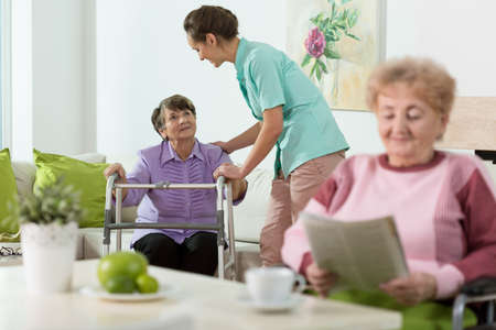 Foto de Disabled senior women staying in care home - Imagen libre de derechos