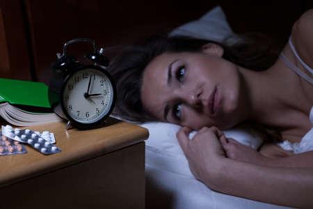 Foto de Woman and her drugs for depression at night - Imagen libre de derechos