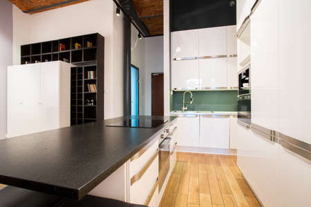 View of small kitchen area inside apartment