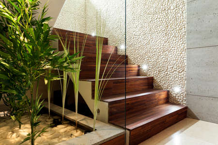 Foto de Illuminated wooden staircase in modern house, horizontal - Imagen libre de derechos