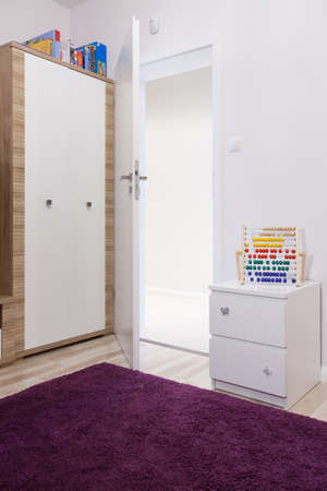 Foto de Close-up of soft violet carpet in child's room - Imagen libre de derechos