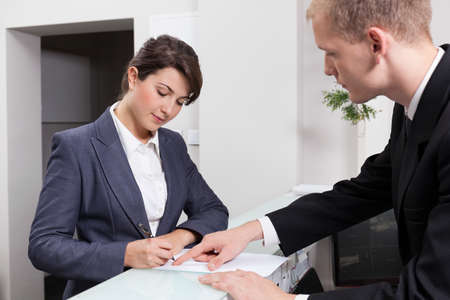 Photo for Horizontal view of attractive businesswoman signing document - Royalty Free Image