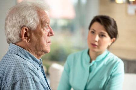 Foto de Lonely senior man staying in retirement home - Imagen libre de derechos