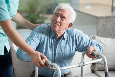 Foto de Disabled senior man being in nursing home - Imagen libre de derechos