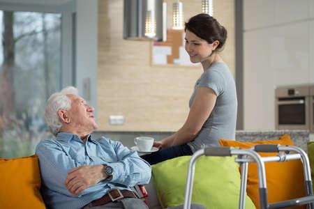 Foto de Grandfather talking with loved granddaughter in his home - Imagen libre de derechos