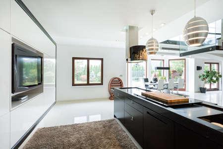 Photo pour Modern elegant kitchen with home movie theater - image libre de droit