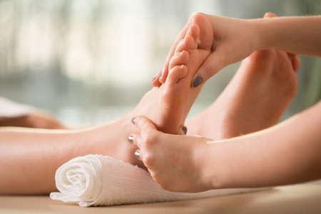 Foto de Close-up of female hands doing foot massage - Imagen libre de derechos