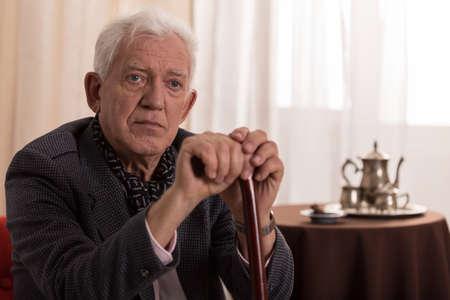 Photo pour Portrait of sad old businessman suffering from loneliness - image libre de droit