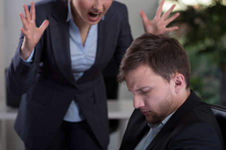Photo for Female boss yelling at employee at work - Royalty Free Image