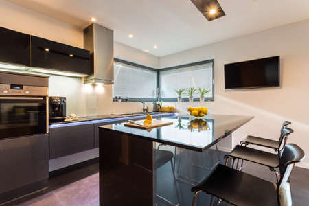 Photo pour Elegant kitchen and dining interior with silver furniture - image libre de droit