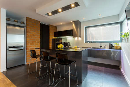 Photo pour Kitchen and dining area in modern apartment - image libre de droit