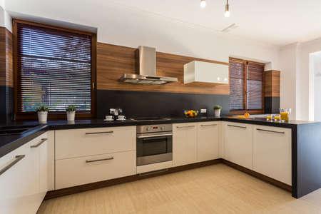 Photo pour Image of new modern kitchen with wooden floor - image libre de droit
