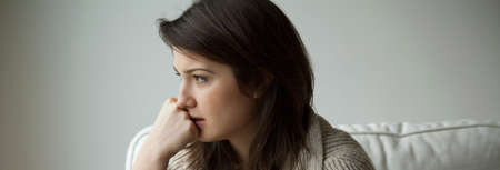 Foto de Sad depressed young woman thinking about her life - Imagen libre de derechos