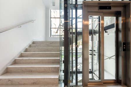 Foto de Stairs and elevator in modern business office - Imagen libre de derechos